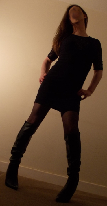 sexy tranny in black striking a pose