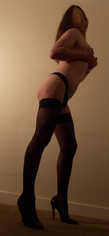 stockings & heels showing off tits